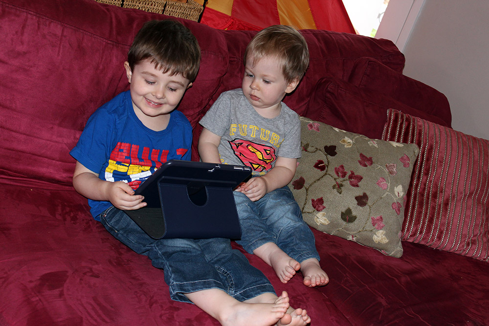 Addi and Pressie Checking Out His New Tablet